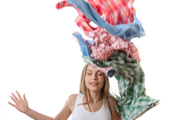 woman throws a pile of clothes, isolated on white