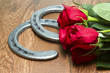canvas print picture - Kentucky Derby Red Roses with Horseshoes on Wood