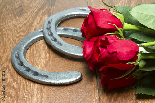 canvas print picture Kentucky Derby Red Roses with Horseshoes on Wood