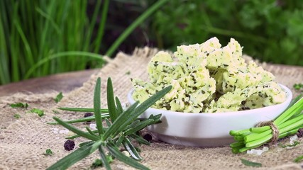 Portion of fresh made Herb Butter (not loopable 4K UHD footage)