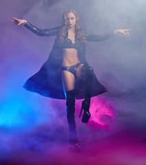 Image of fantastic female dancer in latex lingerie