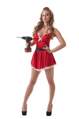 Sexy model posing in Santa dress with drill