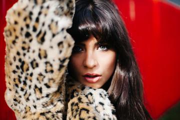 Exotic Model in Vintage Leopard Print Fur Coat