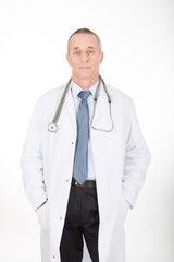 Male doctor with hands in pockets