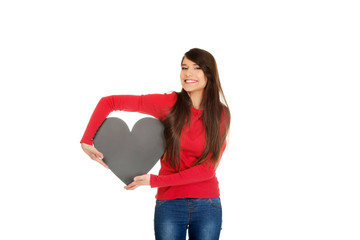 Young woman with heart made from paper.