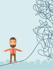 Businessman walking on rope at risk.