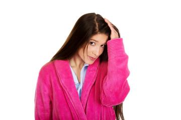Beautiful woman in pink bathrobe.