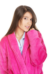Beautiful woman in pink bathrobe.