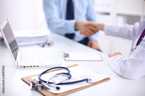 Doctor and Patient sitting on the desk - 81417436