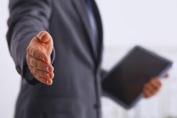 Portrait of businessman giving hand for handshake