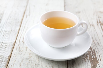 Cup of tea on white wooden