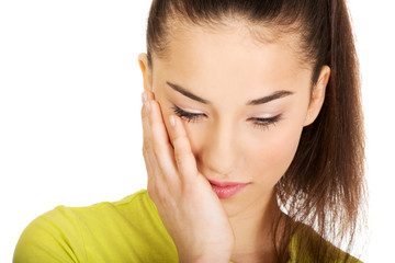 Woman with a toothache touching face.
