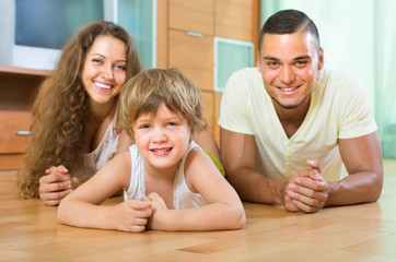 Happy couple with child at home