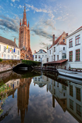 little dock and bridge in a canal of Bruges, Belgium