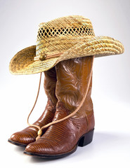 Cowboy life with lizard skin boots and straw hat.