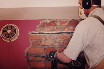 Adult worker remove demolish wall.