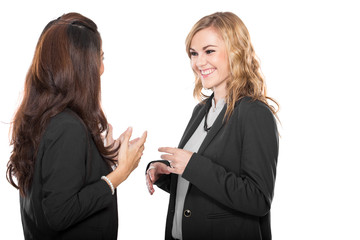 Two happy young businesswoman talking, isolated