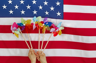 Colorful Wind Twirlers in front of USA Flag