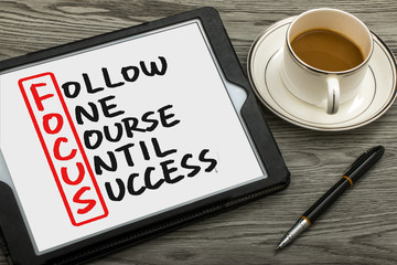 follow one course until success handwritten on tablet pc