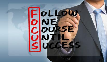 follow one course until success handwritten by businessman