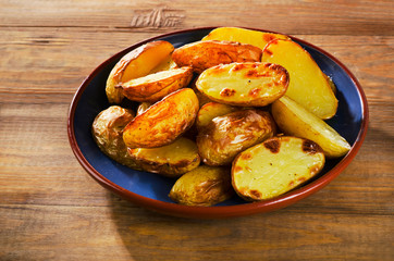 Fried potato on a wooden table