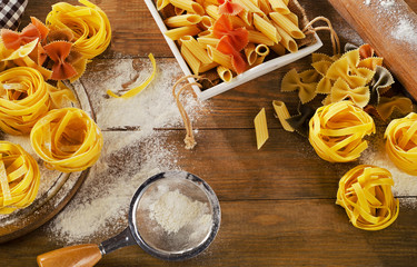Pasta   on  old rustic wooden background