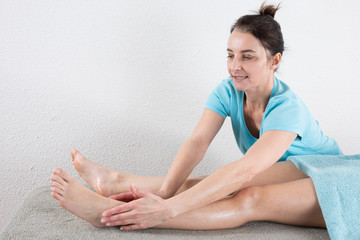 Woman is ready for ankle's massage at  spa