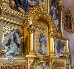 Jesus Christ standing at the door and knocking between angels