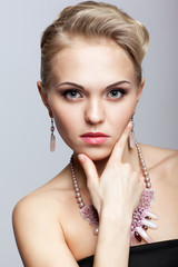 Blonde woman with necklace