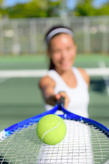 Tennis - woman player showing ball and racket