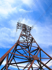 High-voltage tower on blue sky