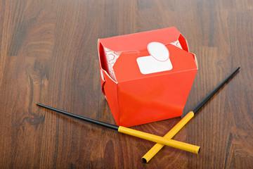 Chinese take away red food box and chopstocks