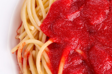 Macro image of ketchup and pasta.