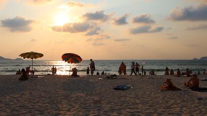 happy sunbathing and recreation activity on beautiful beach