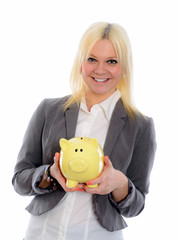 smiling young business woman with piggy bank