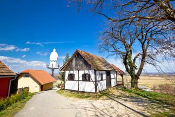 Zagorje hills cottage and st. Vinko statue
