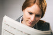 Businesswoman Reads a Newspaper