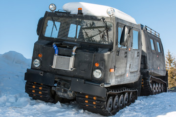 articulated military tracked cargo vehicle on snow