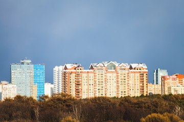 blue gray rainy dark overcast sky over city