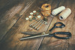 Vintage Background with sewing tools and sewing kit over wooden  - 81427417