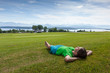 Woman takes rest on green field Norway countryside