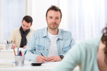 Young attractive man taking exams