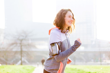 Young attractive woman running at the park
