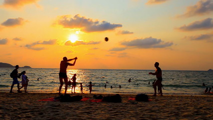 people enjoy playing volleyball, recreation beach activity