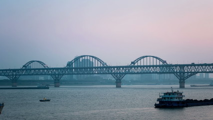 jiujiang yangtze river bridge at dusk, time lapse