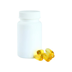Omega 3 gel capsules next to a bottle on white background