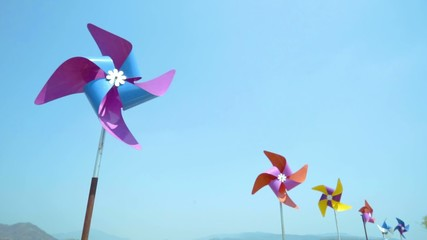 Colorful wind turbine rotating by blowing of wind