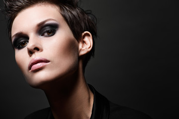 Fashion brunette woman with short hair cut