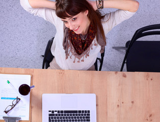Business woman relaxing with  hands behind her head and sitting