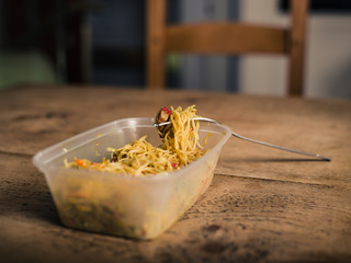 Singapore style noodles on table